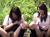 Teen asians watched peeing outdoors